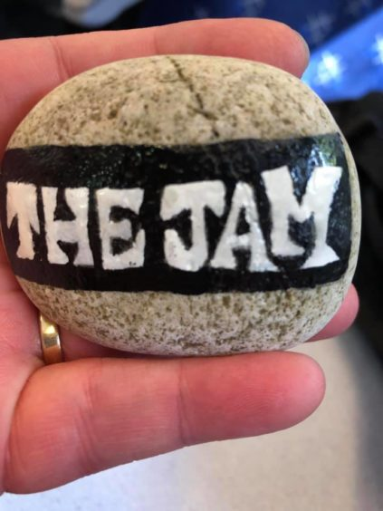 Hopefully this rock designed with The Jam's logo wasn't hidden underground.