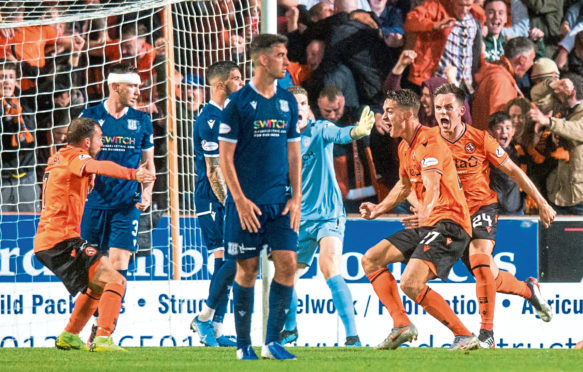 The action at Tannadice on Friday.