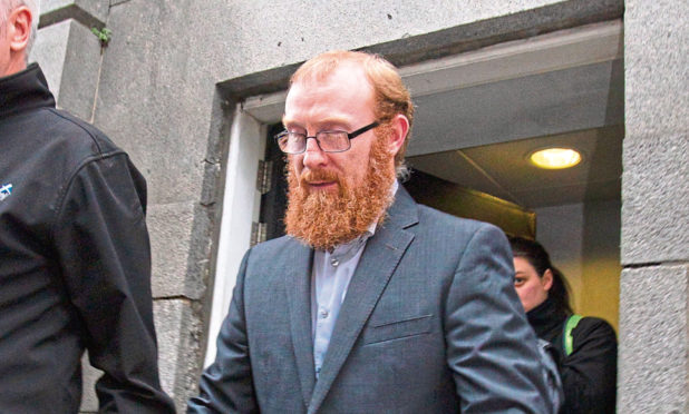Karl Morris, also known as Andrew, leaving court after sentencing at Aberdeen's High Court.