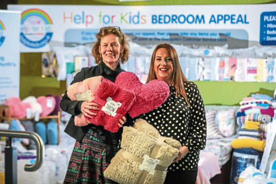 Morag Dennis, operations manager of Overgate, pictured with Hannah Kemlo from Help for Kids, praised staff and shoppers.