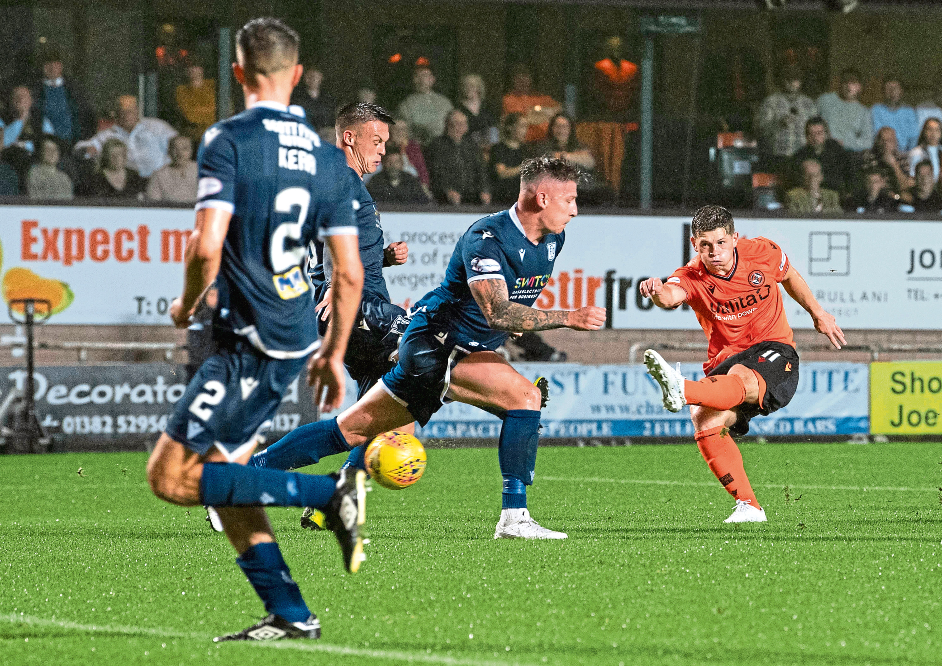 Cammy Smith scores to make it 6-2 during the Dundee derby on August 30.