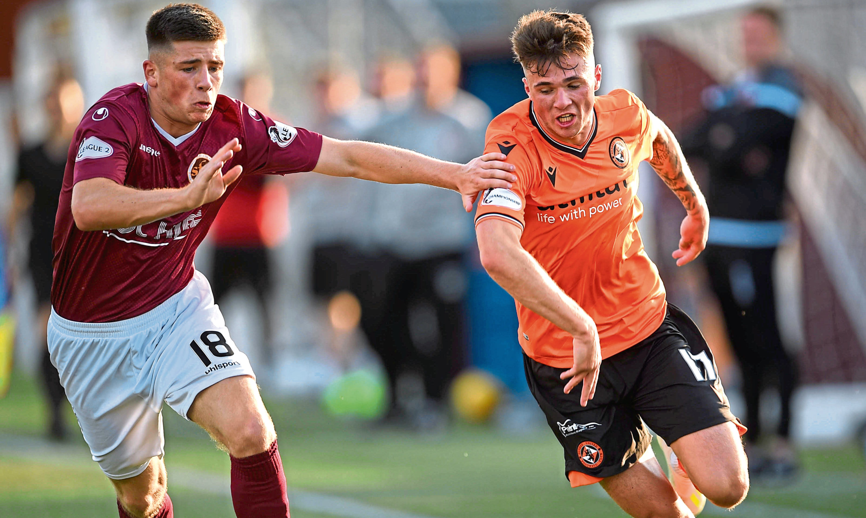 Twenty-one-year-old left-back Jamie Robson (right) has signed a new contract that will keep him at Tannadice until the summer of 2022.