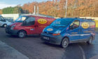 An image of Neil Anderson's work vans.