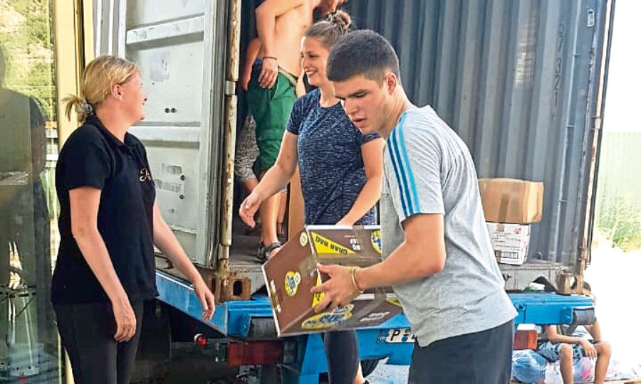 Volunteers load the containers.