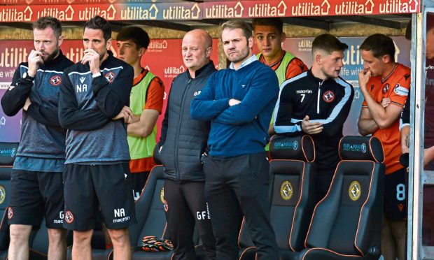 The United bench look on during the match against Arbroath on Sunday in the Challenge Cup.