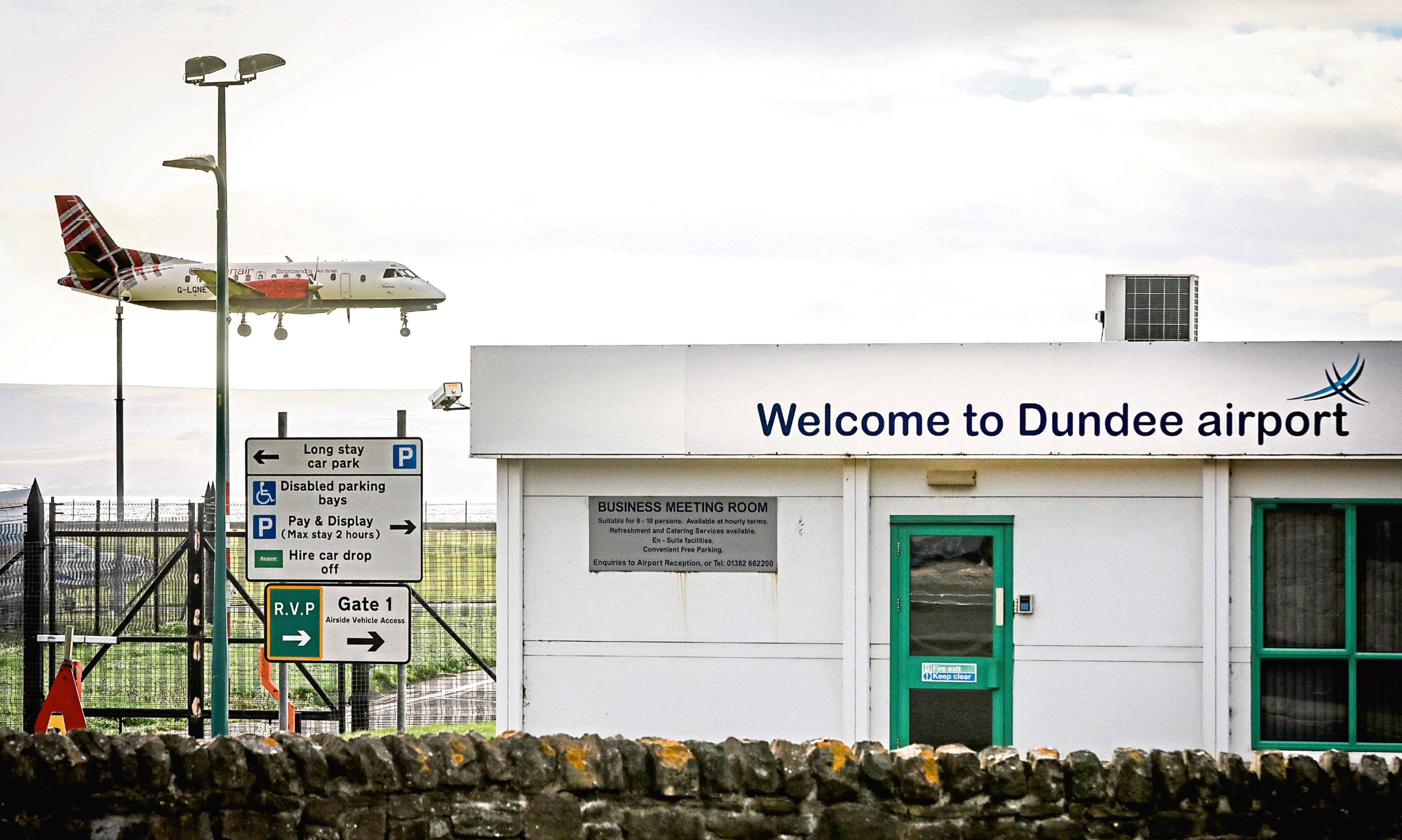 A plane landing at Dundee Airport.