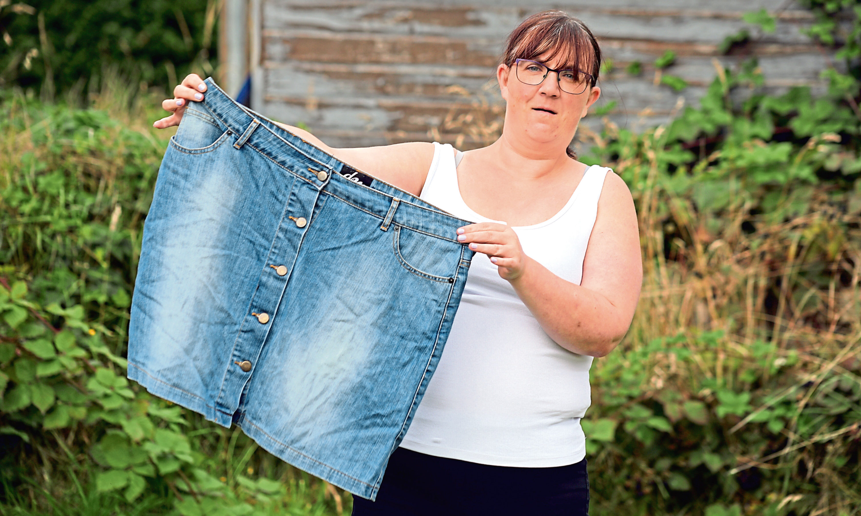 Ruby Hercus with an old pair of shorts - a reminder of how much weight shes lost.