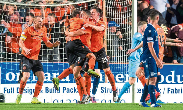 United star Louis Appere celebrates his goal during the Dundee derby in September.