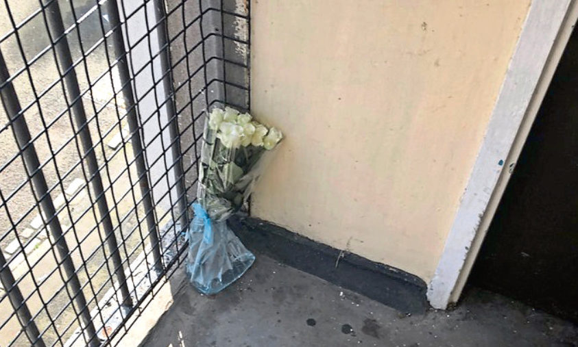 Floral tributes at the block of flats.