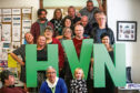 Some of the service users and staff at HaVeN, Hearing Voice Network.