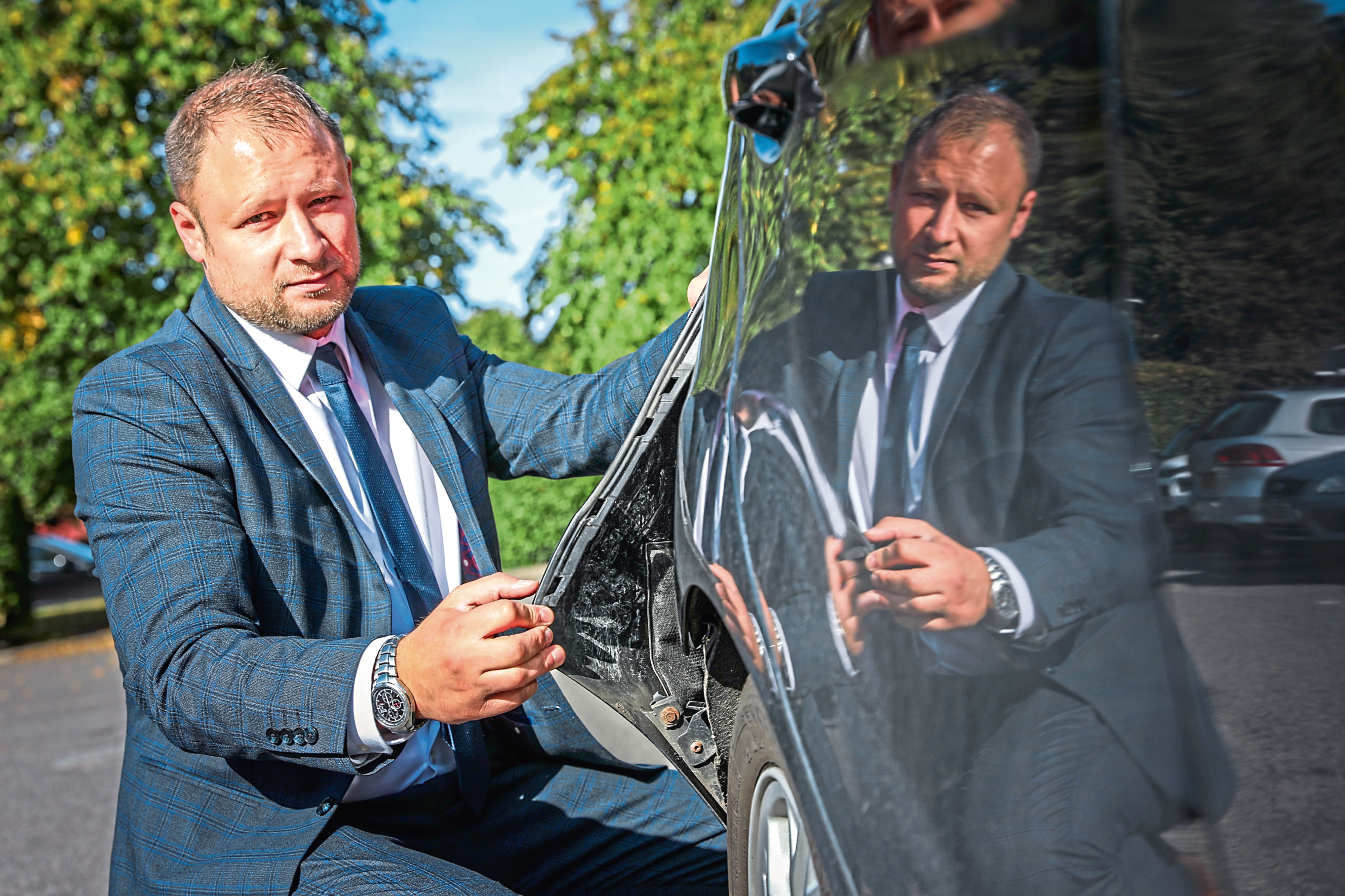The Evening Telegraph, CR0014241, News, Greg Flucker story, David Dalgarno's car was badly damaged on a street in Carnoustie. Picture shows; David Dalgarno with his damaged car. Monday 16th September, 2019. Mhairi Edwards/DCT Media