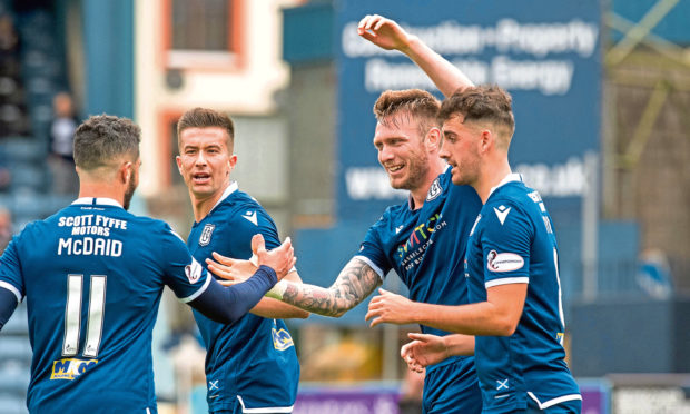 Dundee's Jordan McGhee celebrates his goal during the match between Dundee and Alloa.