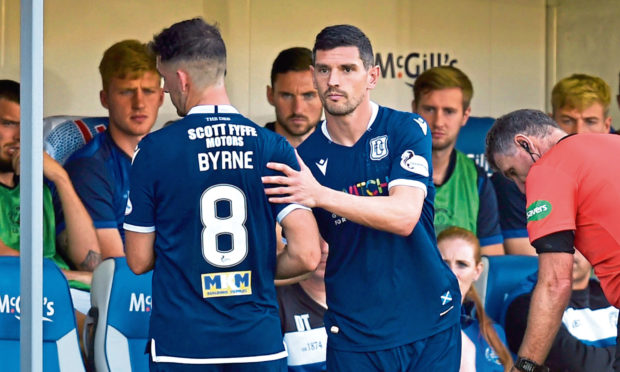 Dundee's Graeme Dorrans, right, making his debut for Dundee.