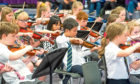 Kids from across city are playing in the orchestra.