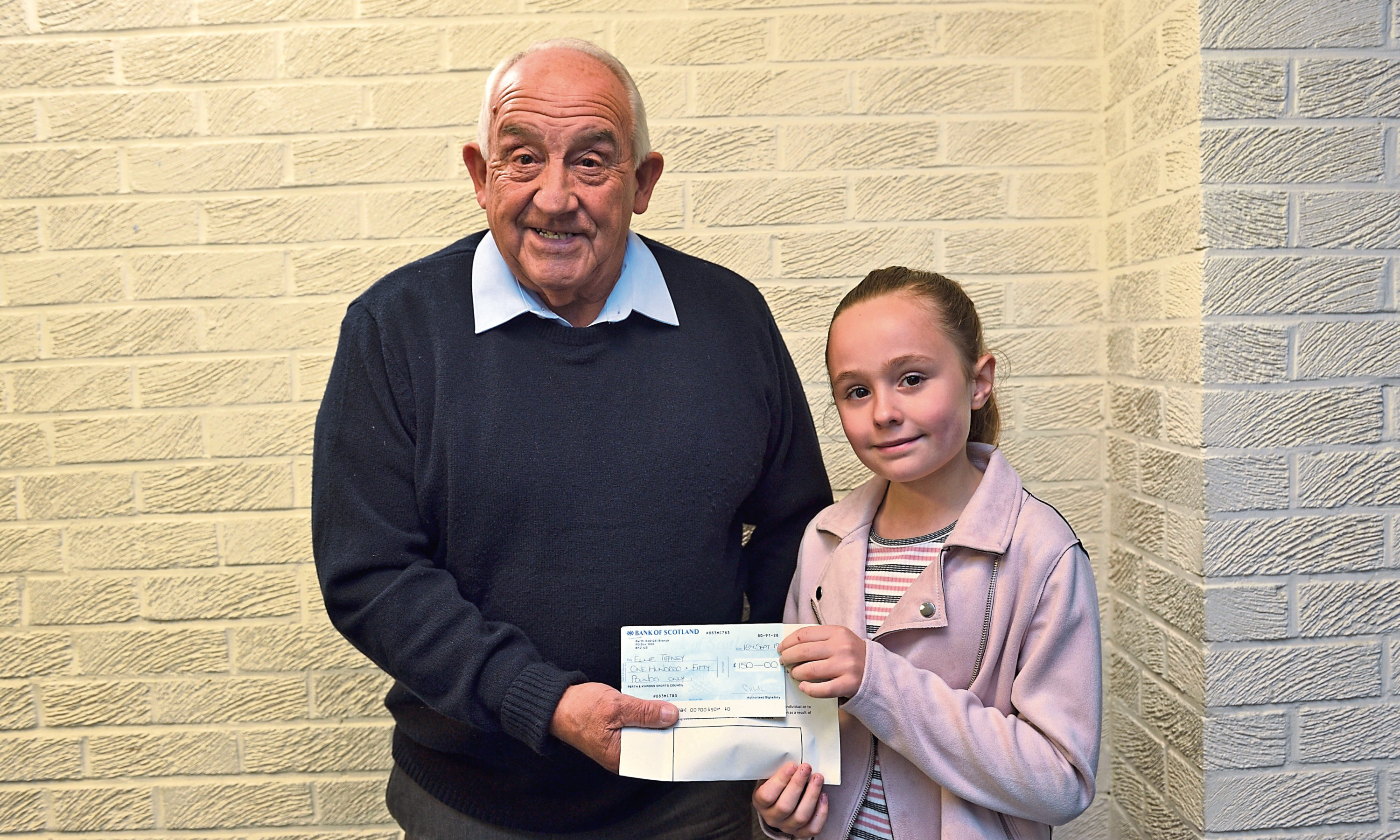 David Taylor, of Perth and Kinross Sports Council. presenting a £150 grant to dancer Ellie Tiffney.