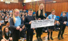 St Mary's RC primary pupils handing over the cheque to the Archie Foundation.
