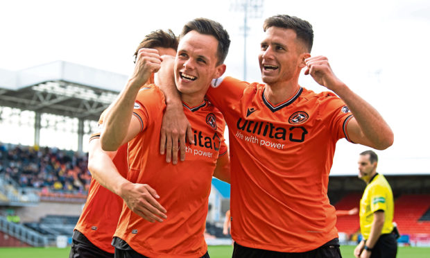 Lawrence Shankland celebrates his second goal with Adrian Sporle.
