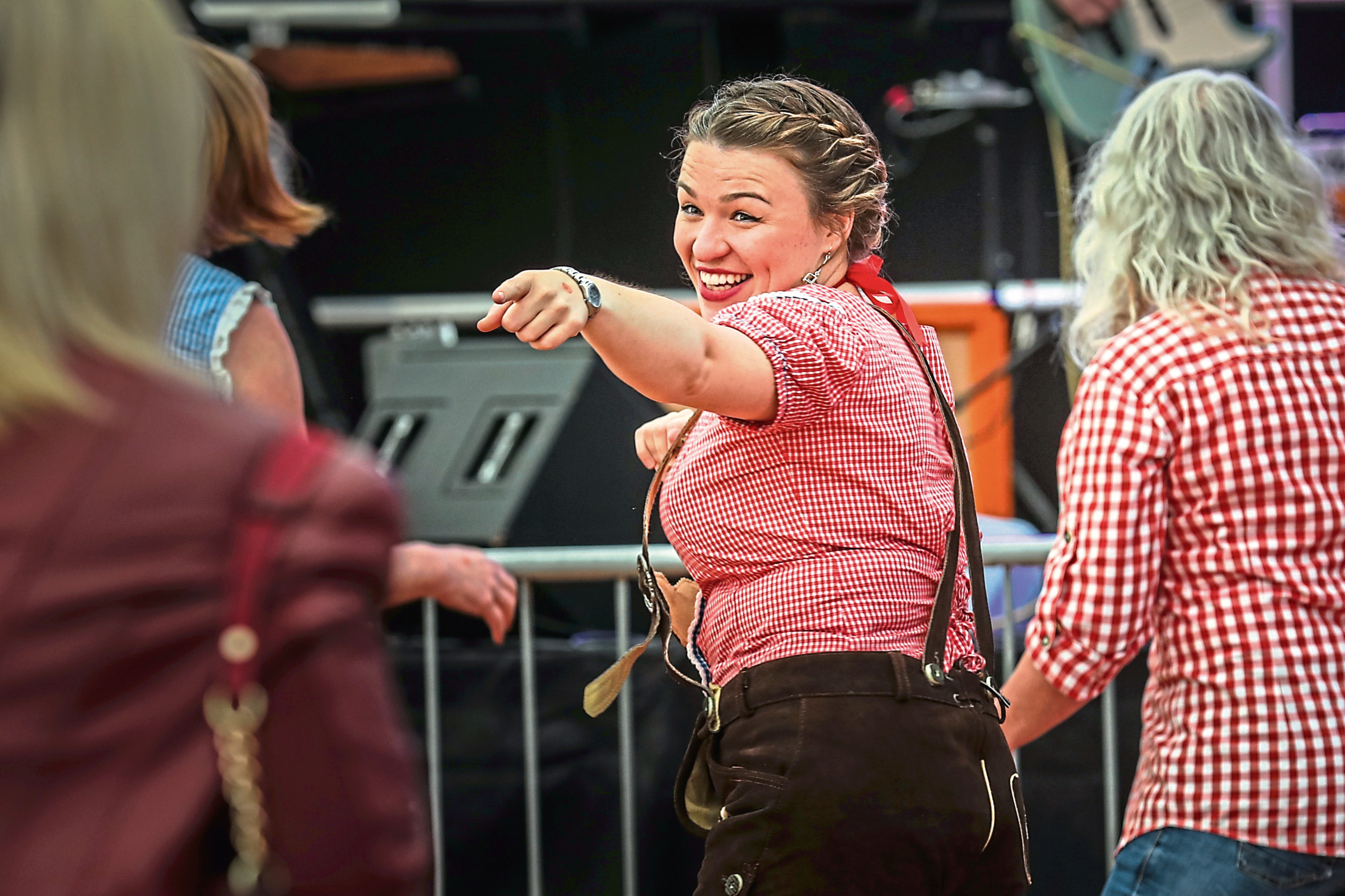 The Courier, CR0014754, News, Scott Milne story, Oktoberfest is now in full swing with crowds enjoying drinks, live music etc down at Slessor Gardens. Picture shows; the crowds enjoying listening and dancing to the band 'Captain Jack'. Saturday 28th September, 2019. Mhairi Edwards/DCT Media