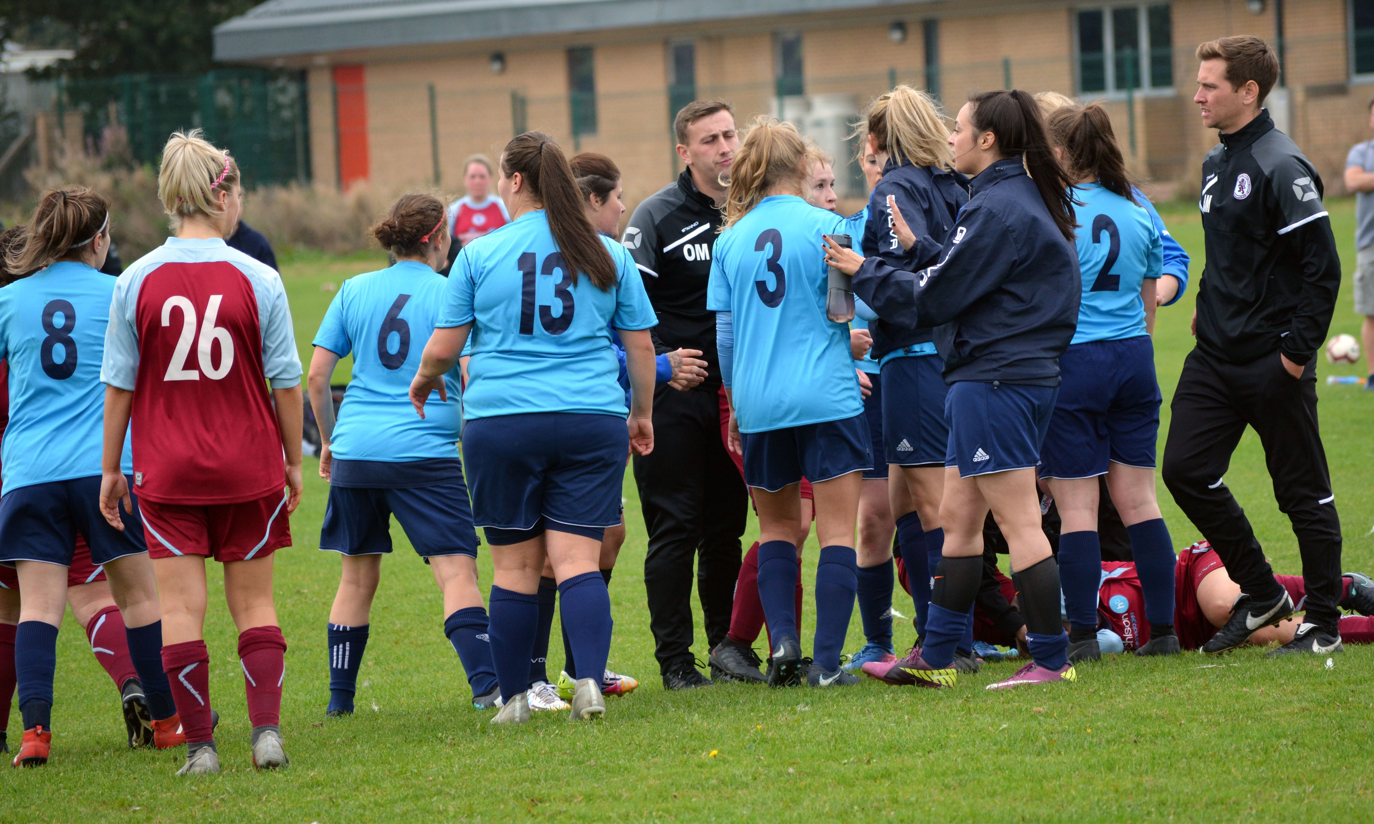 The match between Dundee City WFC (in blue) and Dryburgh Ladies ended in a player being hospitalised.