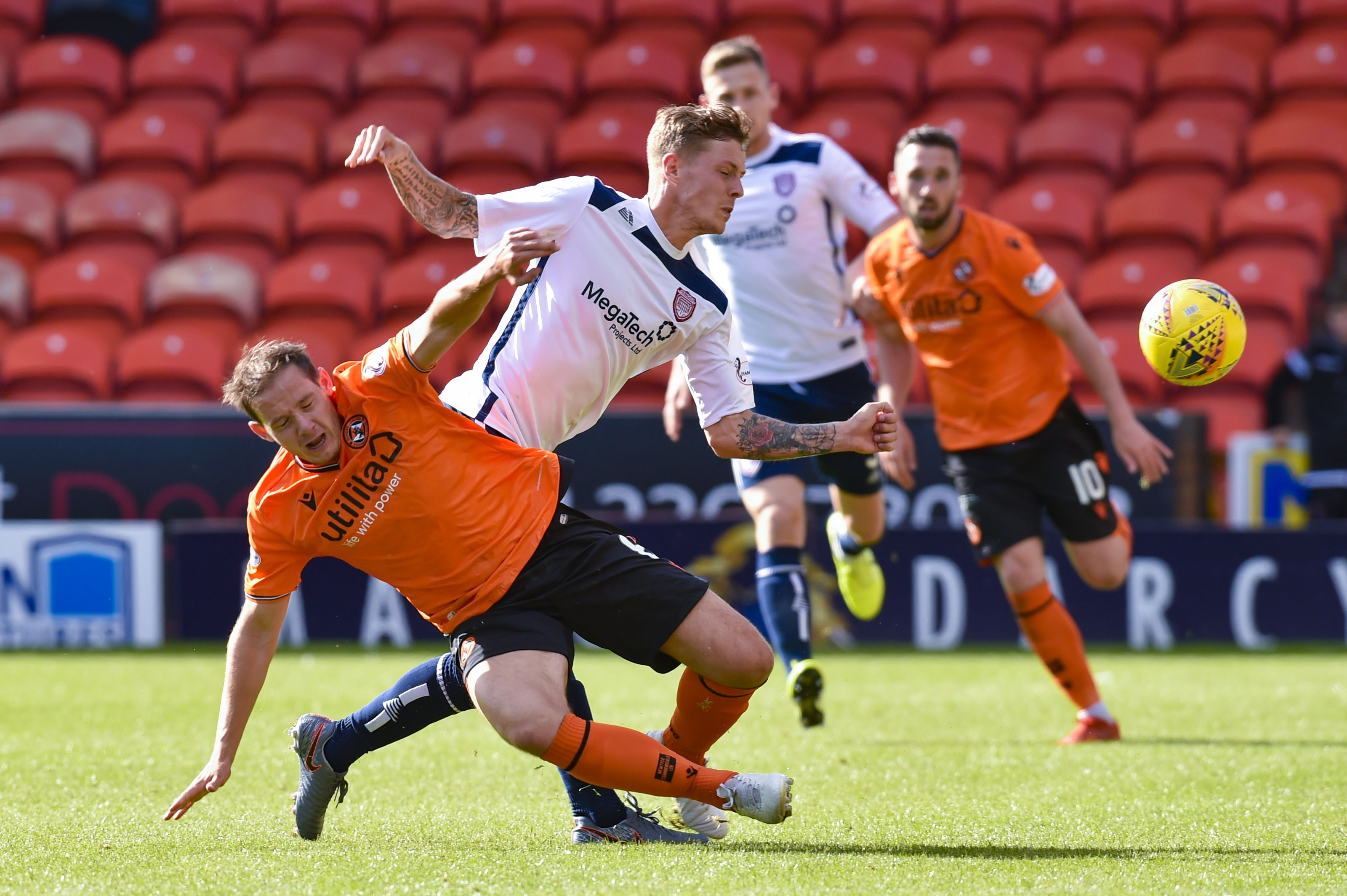 Dundee United's Peter Pawlett (L) in action with Arbroath's Thomas O'Brien during the Tunnock's Caramel Wafer Challenge Cup match between Dundee United and Arbroath on September 7.