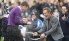 Victor Perez, left, celebrates as he wins the 2019 Dunhill Links at St Andrews.