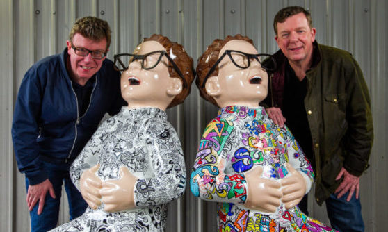 The Proclaimers, Craig, left, and Charlie Reid, with their statues.