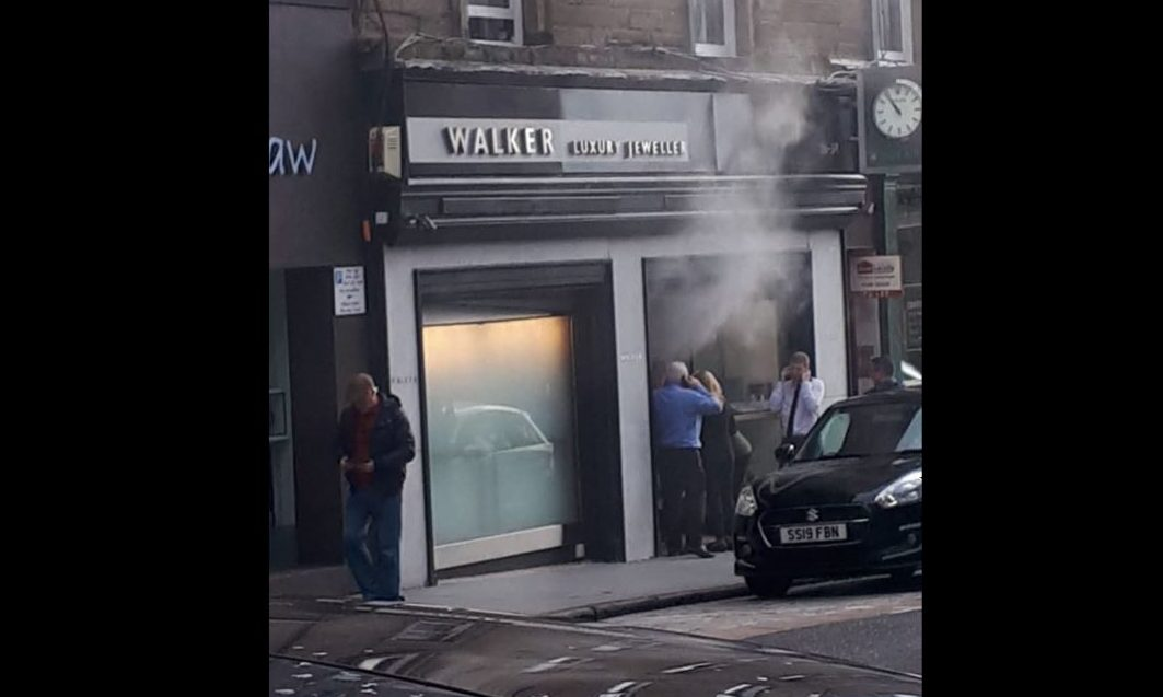 Smoke was seen billowing from the premises.