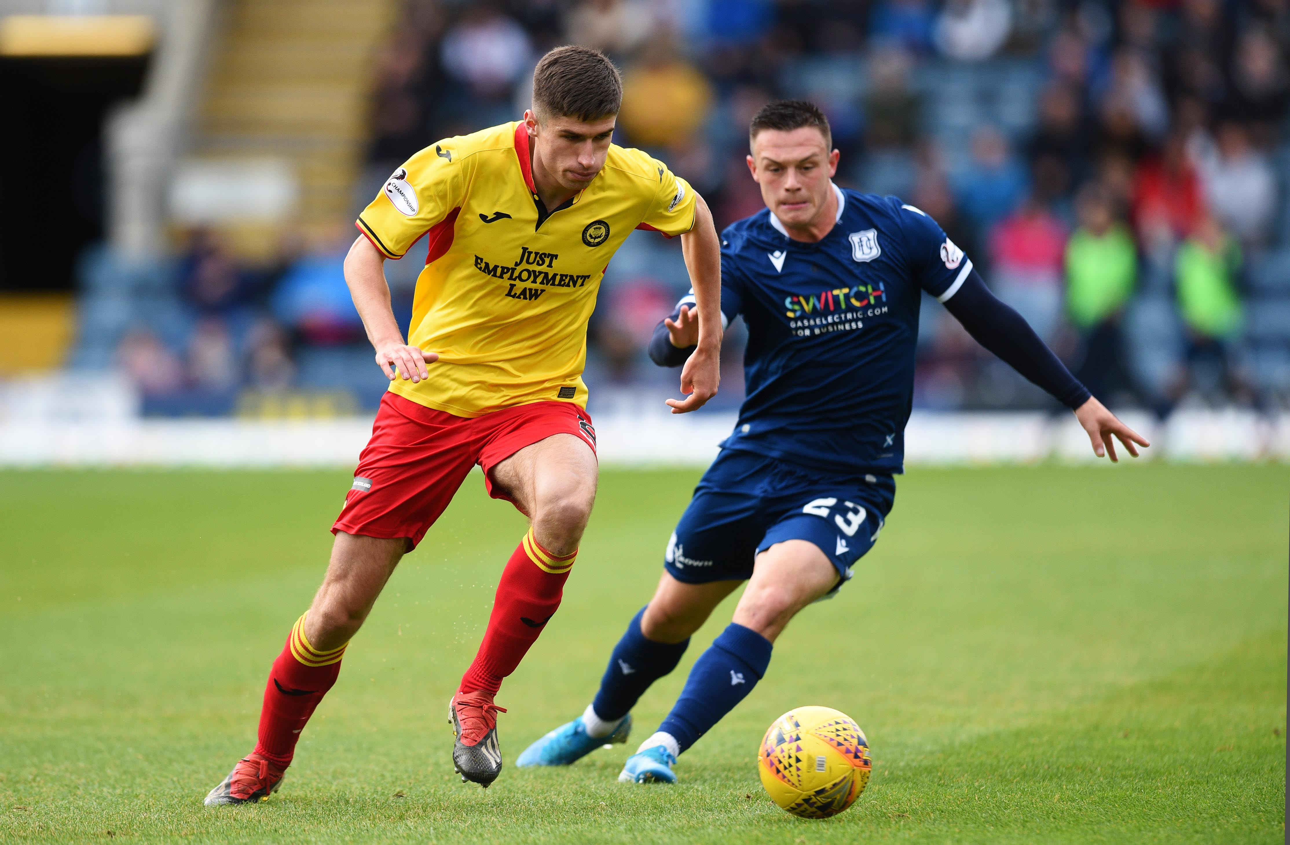 Jordan Marshall chases down Partick's Ryan Williamson.