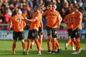 Nicky Clark (No 10) is congratulated by his team-mates after doubling Dundee United's lead.