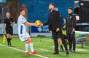Graham Dorrans with manager James McPake during the Ladbrokes Championship match between Queen of the South and Dundee at Palmerston Park.