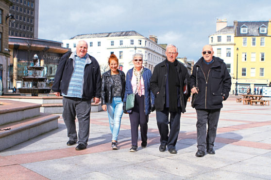 Members of the Dundee Pensioners Forum in the City Square in Dundee.