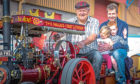 Tom Wallace driving his 4in-scale Burrell Traction Engine, while Lily, 2, Jacob, 4 and Ross Lockhart enjoy the ride.