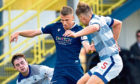 Andrew Nelson, centre, pictured in action against Morton.