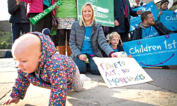 A rally was held outside the Scottish Parliament in Edinburgh in support of the Children (Equal Protection from Assault) (Scotland) Bill.