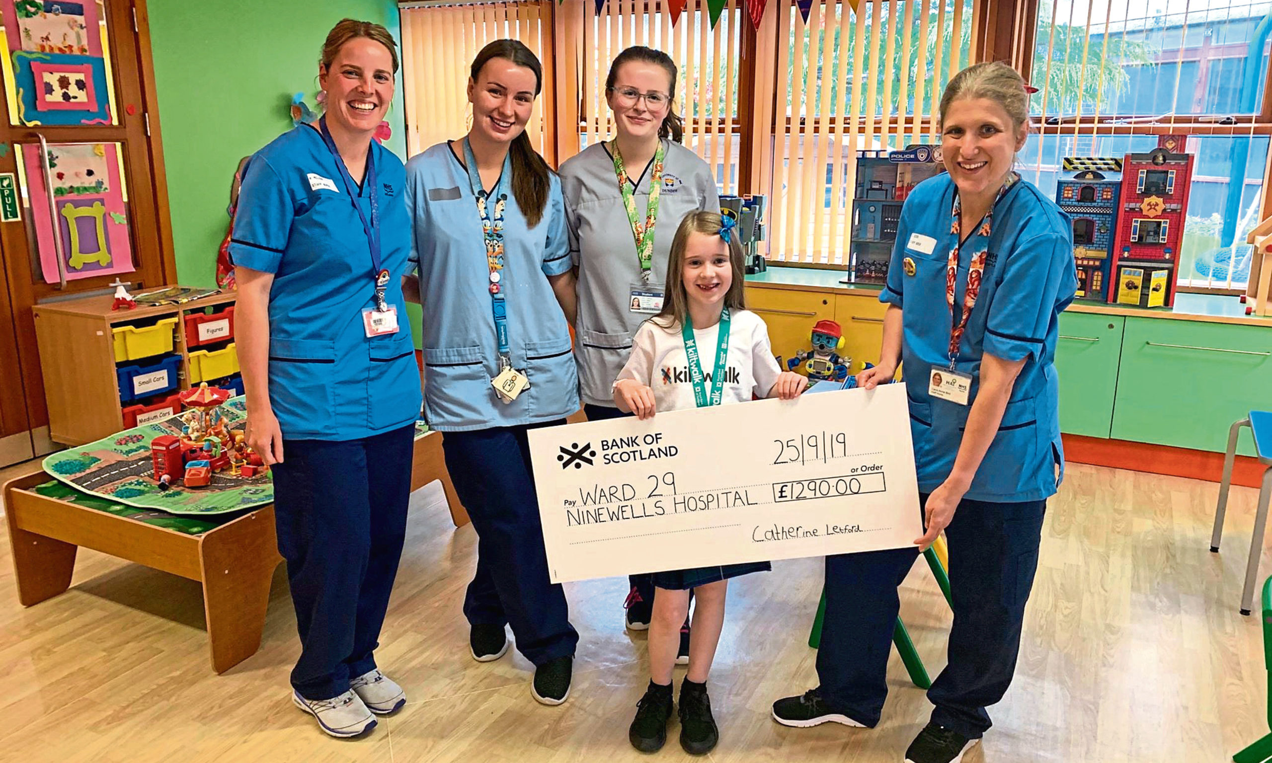 Catherine Letford has presented a cheque to Ninewells Hospital after completing the Kiltwalk where she made friends with weather presenter Sean Batty.  She also has a new friend at home after mum and dad bought Oor Pc Murdoch at the auction.