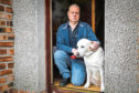 Bobby McNab with his retired guide dog Queenie.