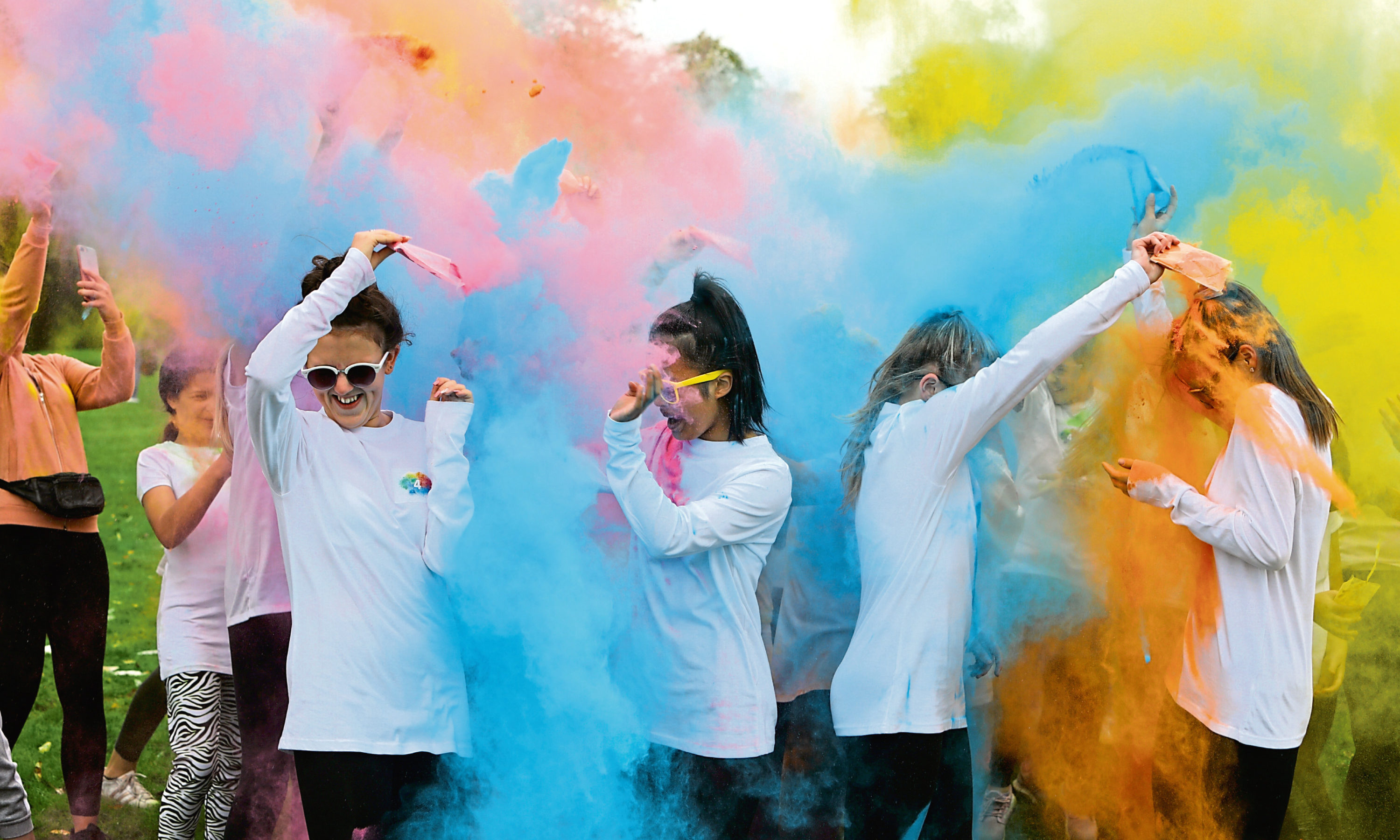 Coloured powder gets thrown at the start of one of the races at Baxter Park.