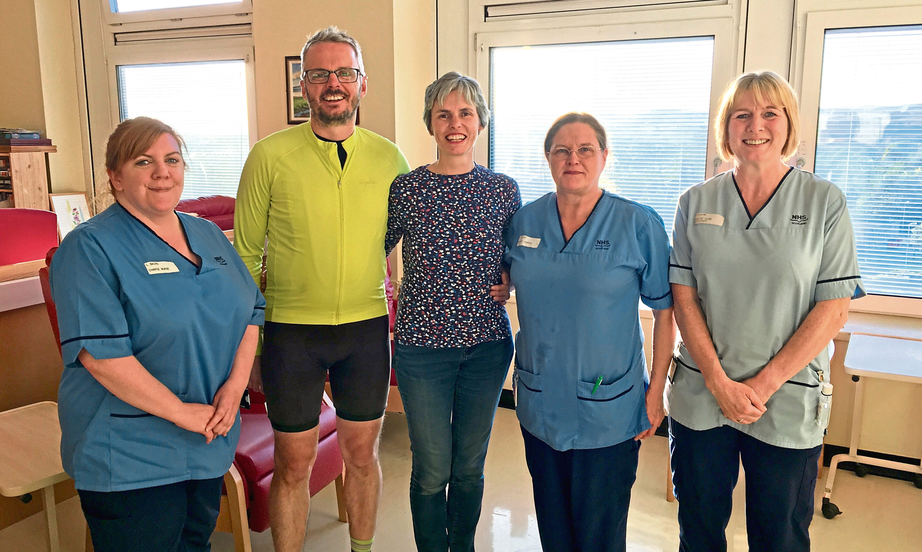 From left: Laura Baird, Matthew Hallam and Emma Gray with staff from Ward 34 at Ninewells Hospital.