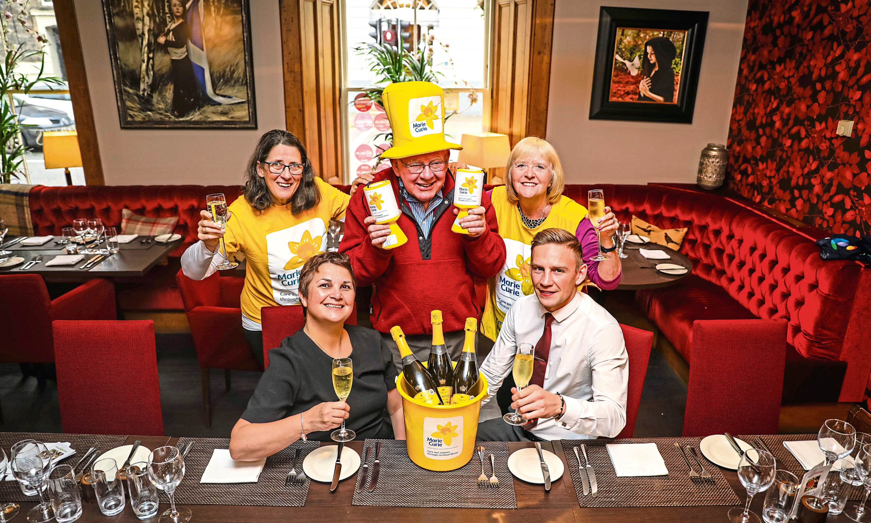 Martine Sinclair and Lee Deans, front, with, back from left, Alyson Johnston, Philip Gill and Marion Thomson from Marie Curie.