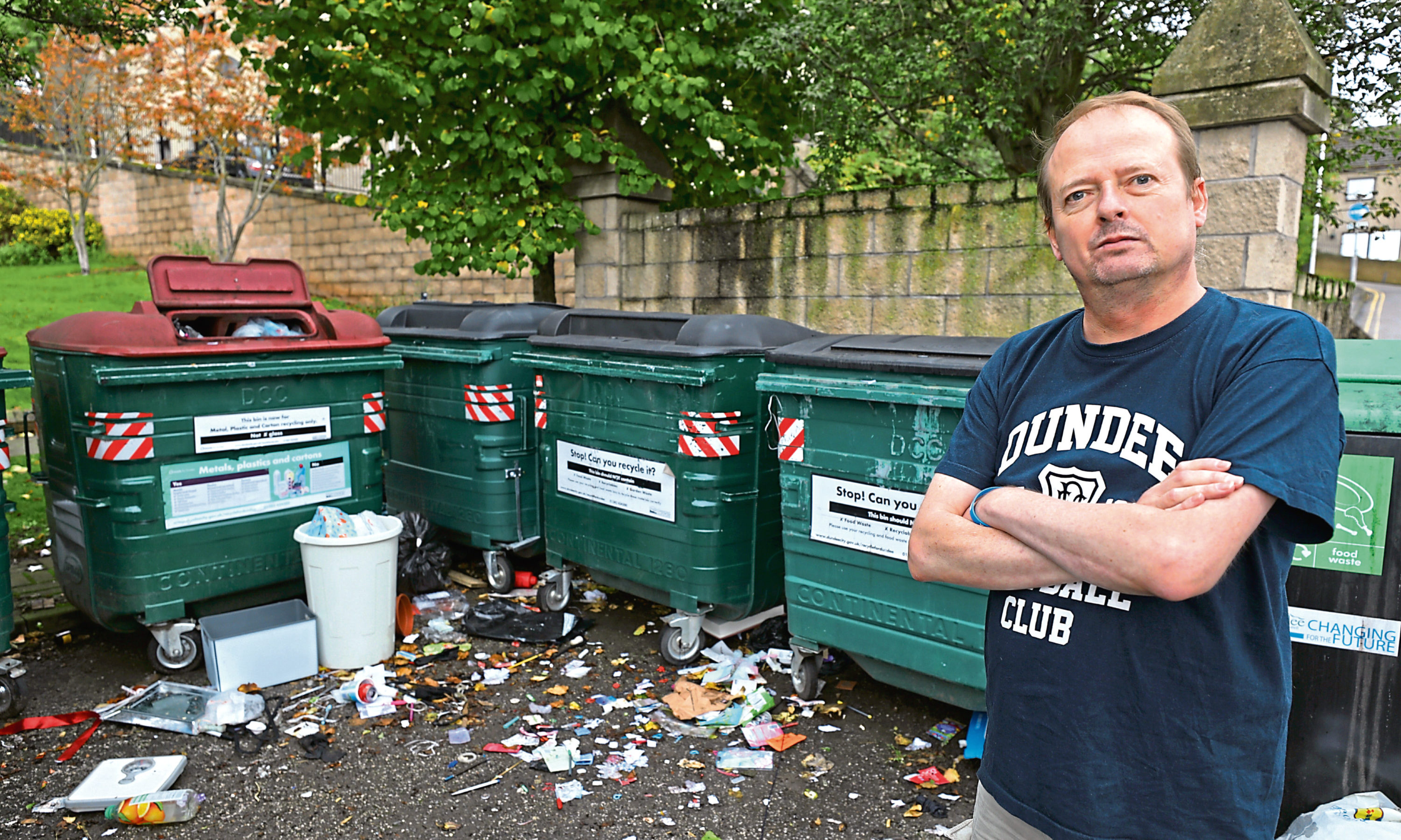 Alan Young beside the overflowing bins at Bonnethill Place.