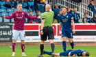 Arbroath's Miko Virtanen is booked for a bad challenge on Dundee's Shaun Byrne.