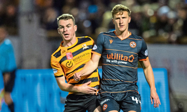 Dundee United's Paul Watson, right, is pictured in action with Alloa Athletic's Adam Brown.