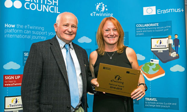 Sharon pictured receiving the national award from British Council Schools Ambassador George Glass.