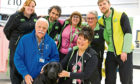 Staff members and volunteers from Guide Dogs Scotland with Ernie.