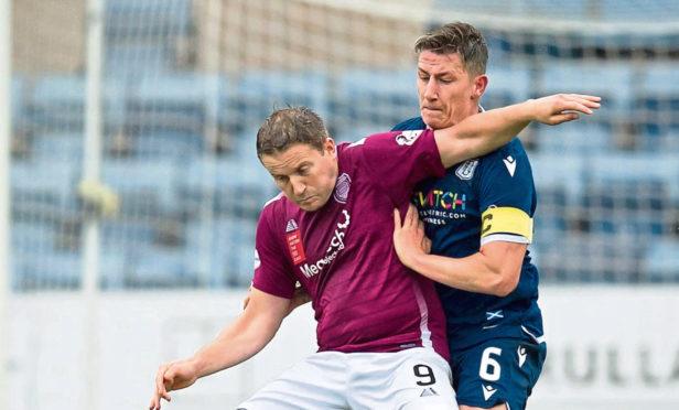 Josh Meekings of Dundee tussles with Steven Doris of Arbroath.