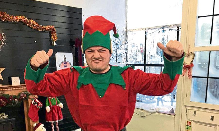 Myles dressed as a Christmas elf.