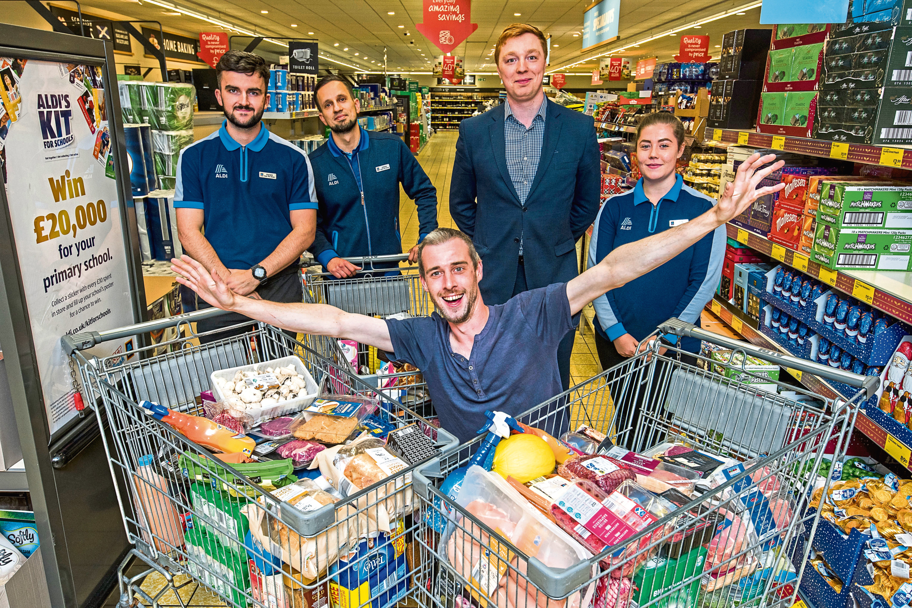 Andrew with Aldi staff, from left: Fraser Ogilvie, Adrian Kazanecki, area manager Callum Ross and Erin Cahill.