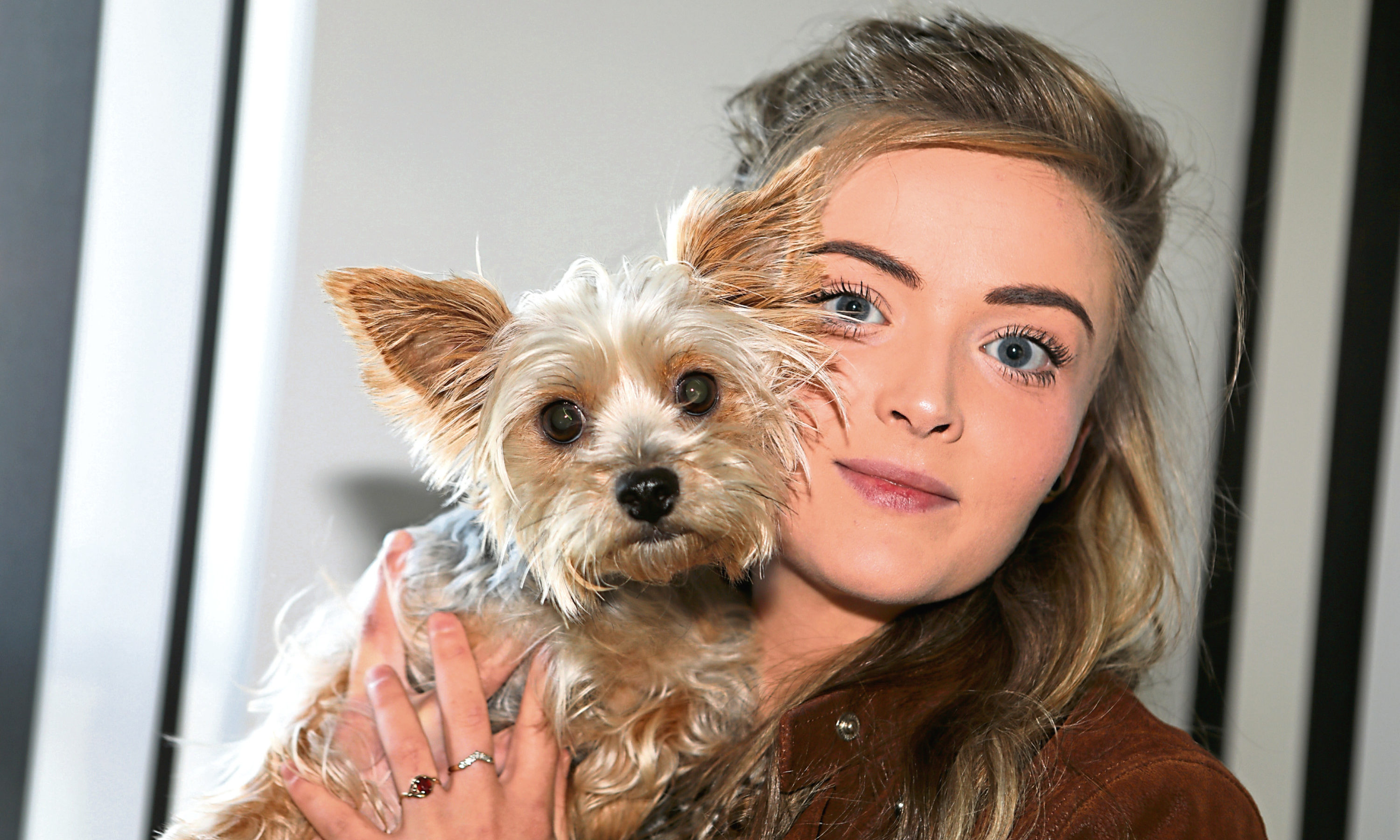 Rebecca McIntosh, 25, with Yorkshire terrier Millie.