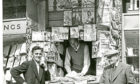 """The old """"Hub"""" news stand in Dundee city centre, which was at one point the smallest shop in the UK, shown here in 1960."""