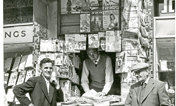 "The old ""Hub"" news stand in Dundee city centre, which was at one point the smallest shop in the UK, shown here in 1960."